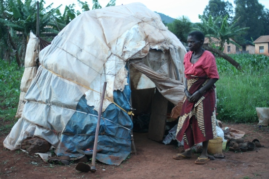 Evicted community members trying to make-do with little resources they have to make shelters after an eviction to pave way to multinational mining project. Photo by Afrikayetu